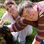 two women petting dog
